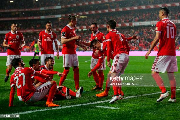 Benfica players celebrate a goal during the Portuguese league football match between SL Benfica and CS Maritimo at the Luz stadium in Lisbon on March...