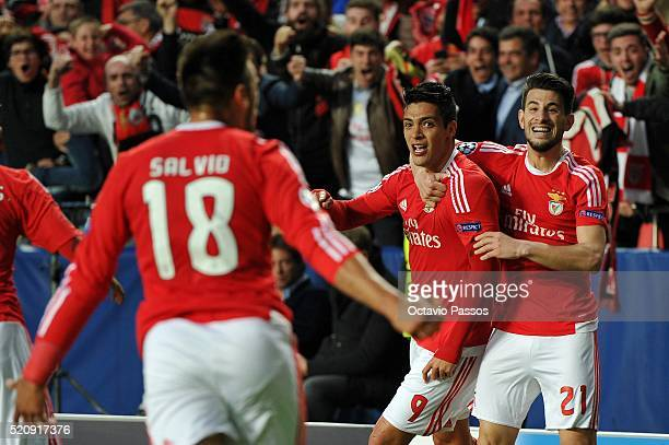 Benfica players celebrate the first goal against FC Bayern Muenchen during the UEFA Champions league Quarter Final Second Leg match between SL...
