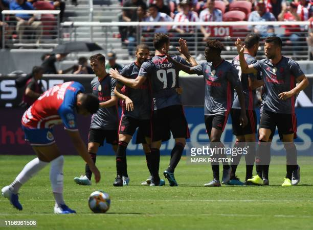 Benfica players celebrate their third goal against Chivas de Guadalajara during their 2019 International Champions Cup match at the Levi's Stadium in...
