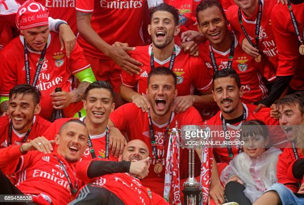 Benfica players celebrate their victory with the trophy at the end of the Portugal's Cup final football match SL Benfica vs Vitoria SC at Jamor...
