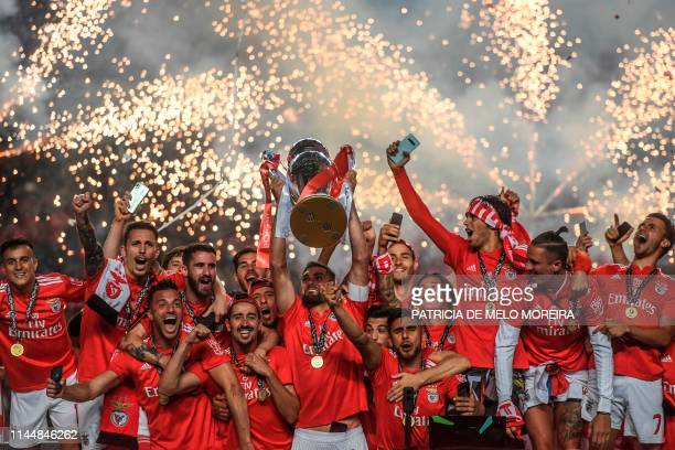 TOPSHOT Benfica players celebrate with the trophy as Benfica they won the Portuguese League Championship at the end of the Portuguese League football...