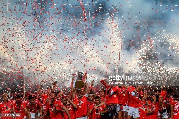 Benfica players celebrate with the trophy as Benfica they won the Portuguese League Championship at the end of the Portuguese League football match...