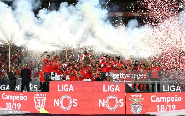 Benfica players celebrate with trophy after winning at the end of the Liga NOS Championship the Liga NOS match between SL Benfica and CD Santa Clara...