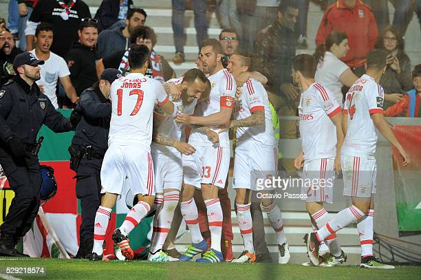 Benfica players celebrating after scoring a goal against CS Maritimo during the Portuguese Primeira Liga at Estadio dos Barreiros on May 8 2016 in...