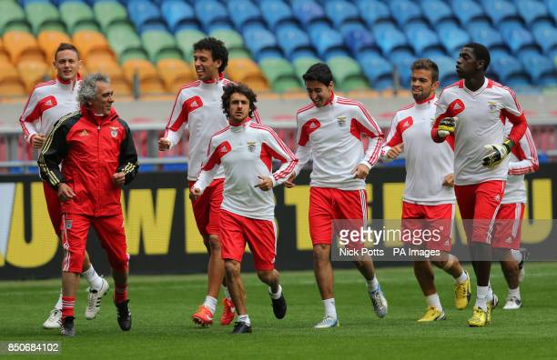 Benfica players lead by Pablo Aimar warm up during a training session ahead of playing Chelsea in Final of the Europa League tomorrow at the...