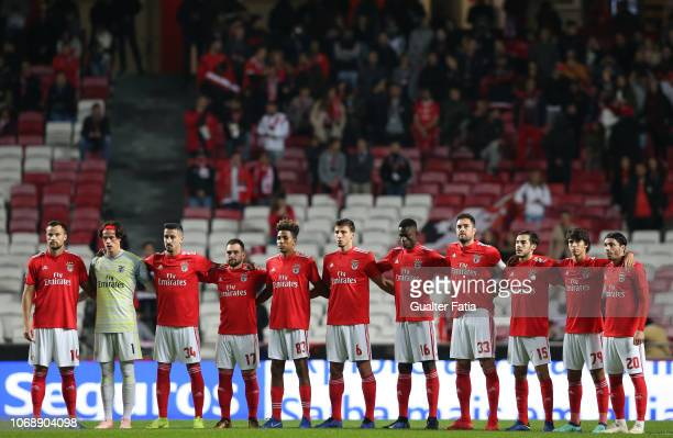 Benfica players line up for a minute of silence before the start of the Portuguese League Cup match between SL Benfica and Pacos de Ferreira at...