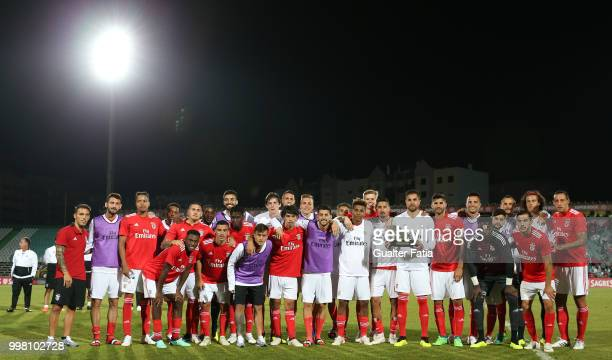 Benfica players pose for a photo with trophy after winning the Sado Tournament at the end of the PreSeason Friendly match between SL Benfica and...