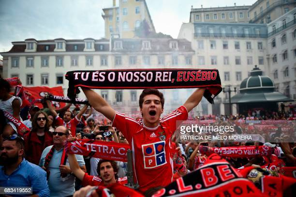 A Benfica supporters hold a scarves as they gather in front of Lisbon's City Hall to celebrate their team's victory in the 20162017 Portuguese League...