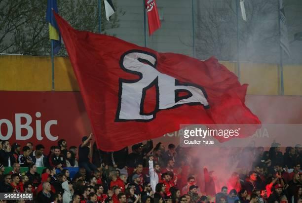 Benfica supporters in action during the Primeira Liga match between GD Estoril Praia and SL Benfica at Estadio Antonio Coimbra da Mota on April 21...