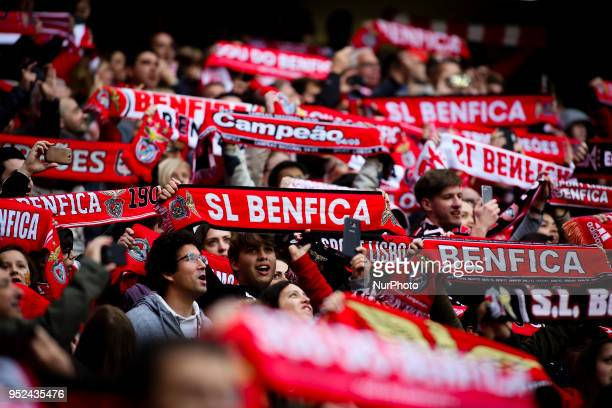 Benfica supporters wave flags during the Portuguese League football match between SL Benfica and Tondela at Luz Stadium in Lisbon on April 28 2018
