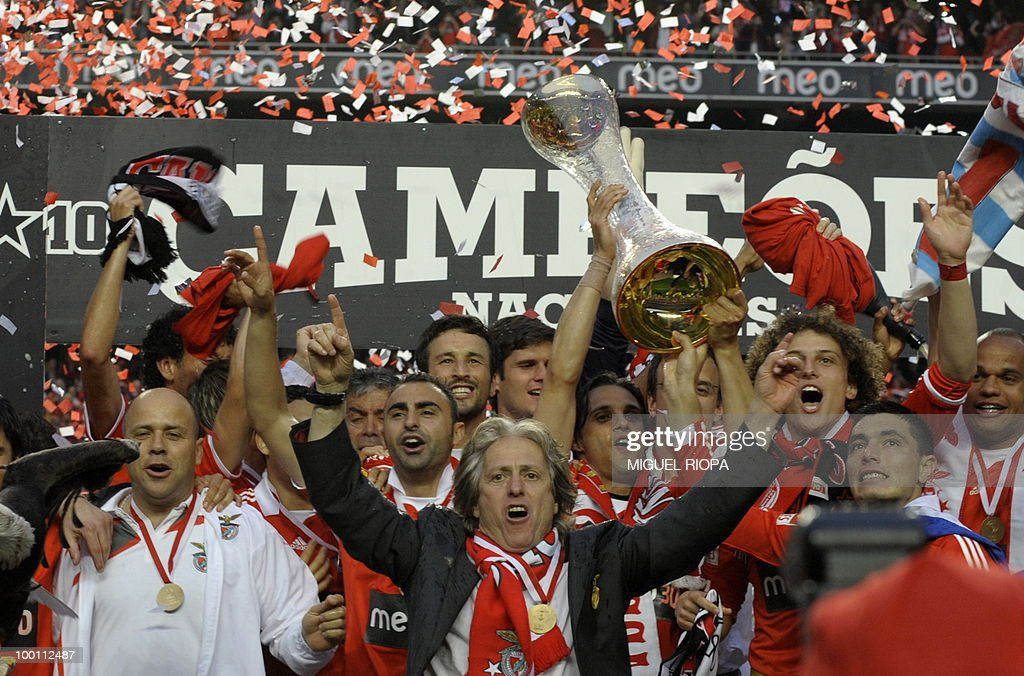SL Benfica team's players celebrate after wining the Portuguese first league 2009-2010 at the Luz Stadium in Lisbon, on May 9, 2010.