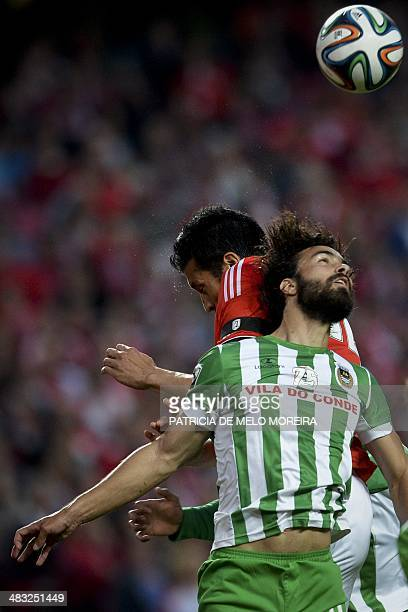 Benfica's Argentine defender Ezequiel Garay heads the ball with Rio Ave's Brazilian defender Marcelo Ferreira during the Portuguese league football...