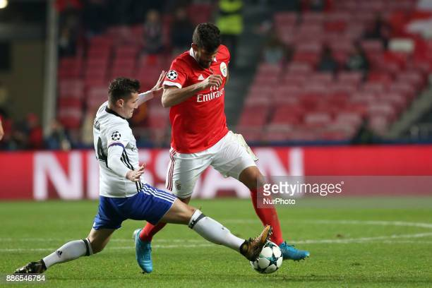 Benfica's Argentine defender Lisandro Lopez fights for the ball with Basel's midfielder Taulant Xhaka from Albania during the UEFA Champions League...