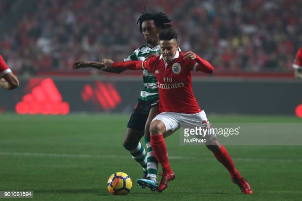 Benfica's Argentine forward Franco Cervi fights for the ball with Sporting's forward Gelson Martins from Portugal during the Portuguese League...
