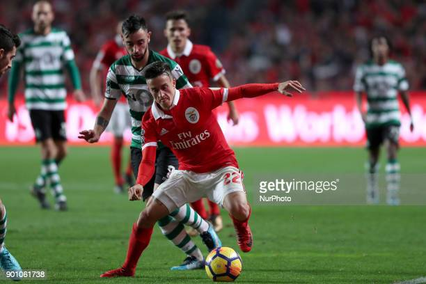 Benfica's Argentine forward Franco Cervi vies with Sporting's midfielder Bruno Fernandes from Portugal during the Portuguese League football match SL...