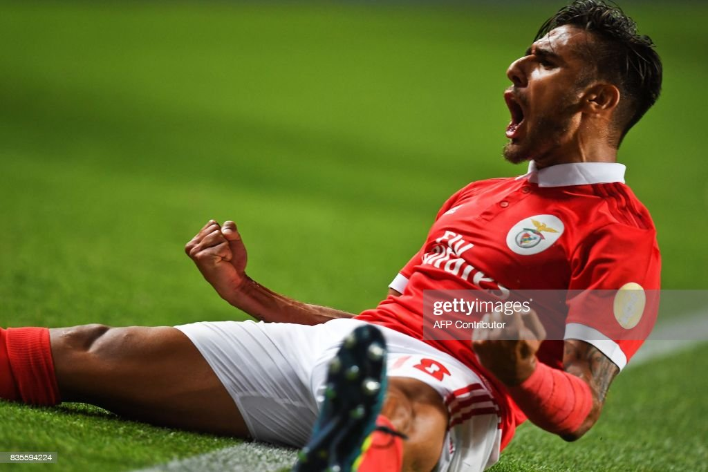 Benfica's Argentine midfielder Eduardo Salvio (R) celebrates after scoring during the Portuguese League football match SL Benfica vs Os Belenenses at Luz stadium on August 19, 2017. /