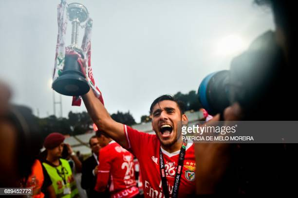 Benfica's Argentine midfielder Eduardo Salvio celebrates with the trophy at the end of the Portugal's Cup final football match SL Benfica vs Vitoria...