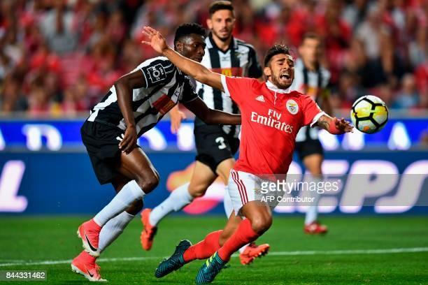 Benfica's Argentine midfielder Eduardo Salvio vies with Portimonense's Ghanaian defender Emmanuel Hackman during the Portuguese league football match...