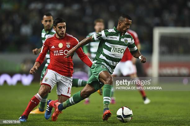 Benfica's Argentine midfielder Eduardo Salvio vies with Sporting's midfielder Luis Carlos da Cunha Nani during the Portuguese league football match...