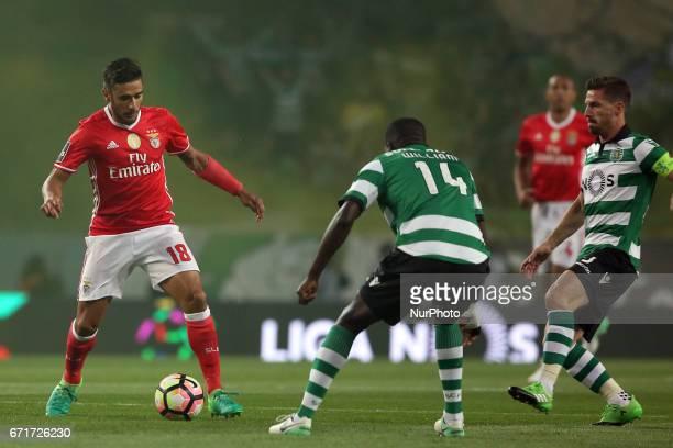 Benfica's Argentine midfielder Eduardo Salvio vies with Sporting's Portuguese midfielder William Carvalho and Sporting's Portuguese midfielder Adrien...