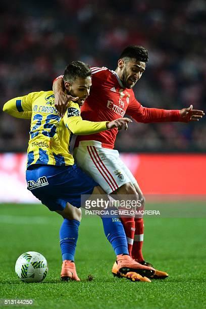 Benfica's Argentine midfielder Eduardo Salvio vies with União da Madeira's forward Miguel Cardoso during the Portuguese league football match SL...