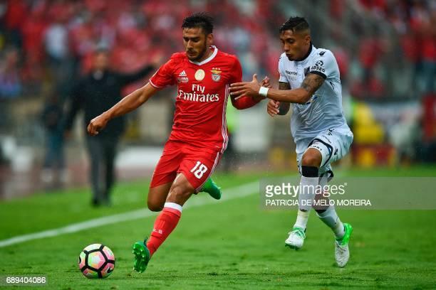 Benfica's Argentine midfielder Eduardo Salvio vies with Vitoria de Guimaraes' Brazilian forward Rafinha during the Portugal's Cup final football...