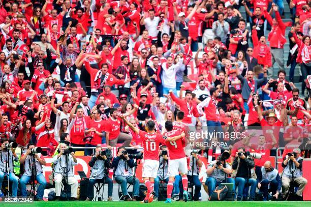 Benfica's Argentinian defender Franco Cervi celebrates with teammates after scoring during the Portuguese league football match SL Benfica vs Vitoria...