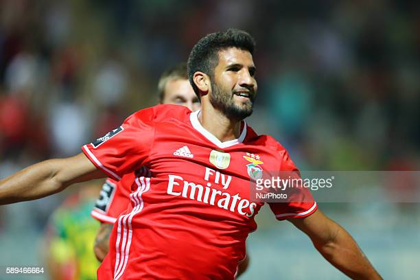 Benfica's Argentinian defender Lisandro Lopez celebrates after scoring a goal during the Premier League 2016/17 match between CD Tondela and SL...