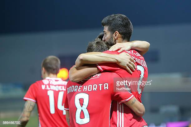 Benfica's Argentinian defender Lisandro Lopez celebrates after scoring a goal with team during the Premier League 2016/17 match between CD Tondela...