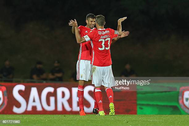 Benfica's Argentinian defender Lisandro Lopez celebrates after scoring a goal with Benfica's Brazilian defender Jardel during Premier League 2016/17...