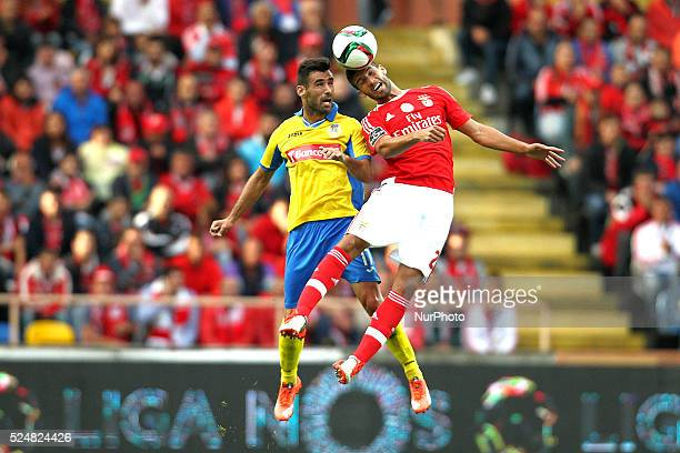 Benfica's Argentinian defender Lisandro L��pez vies with Arouca's Portuguese forward Roberto Rodrigo during the Premier League 2015/16 match between...