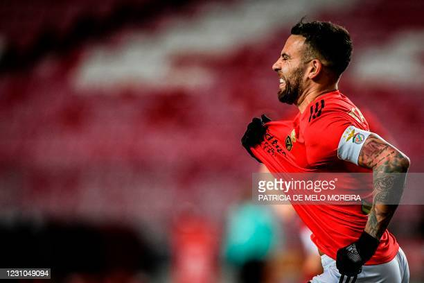 Benfica's Argentinian defender Nicolas Otamendi celebrates after scoring a goal during the Portuguese League football match between SL Benfica and FC...