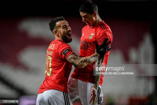 Benfica's Argentinian defender Nicolas Otamendi celebrates with Benfica's Uruguayan forward Darwin Nunez after scoring a goal during the Portuguese...