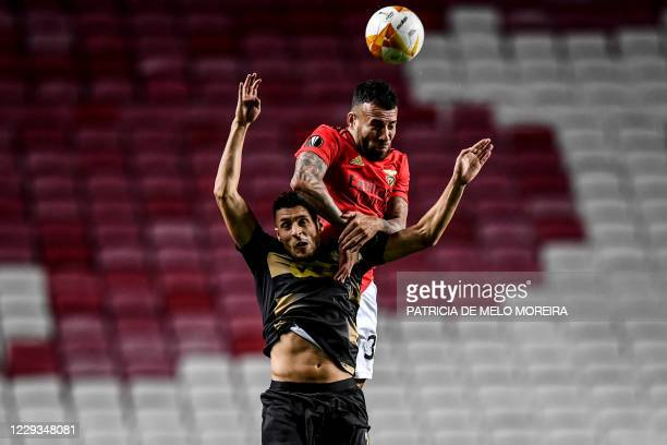 Benfica's Argentinian defender Nicolas Otamendi heads the ball with Standard Liege's Belgian midfielder Selim Amallah during the UEFA Europa League...