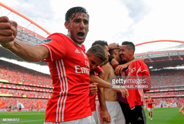 Benfica's Argentinian forward Eduardo Salvio celebrates a goal with teammates during the Portuguese league football match SL Benfica vs Vitoria...