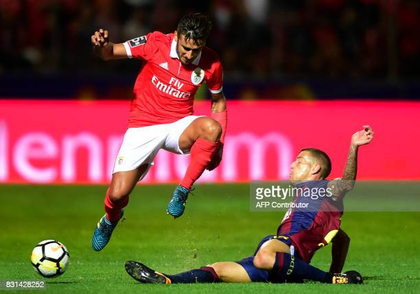 Benfica's Argentinian forward Eduardo Salvio vies with Chaves' midfielder Pedro Tiba during the Portuguese league football match between GD Chaves...