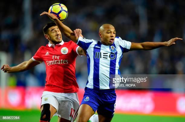 Benfica's Argentinian forward Eduardo Salvio vies with Porto's Algerian forward Yacine Brahimi during the Portuguese league football match FC Porto...