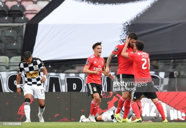 Benfica's Argentinian forward Facundo Ferreyra celebrates with teammates after scoring a goal during the Portuguese league football match between...