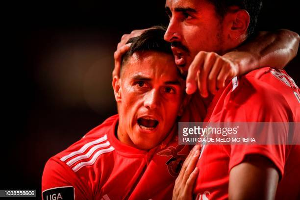 Benfica's Argentinian forward Franco Cervi celebrates a goal with teammate defender Andre Almeida during the Portuguese league football match between...