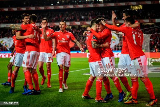 Benfica's Argentinian forward Franco Cervi celebrates a goal with teammates during the Portuguese League football match between SL Benfica and...