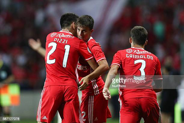 Benfica's Argentinian forward Franco Cervi celebrates after scoring a goal with Benfica's Portuguese midfielder Pizzi and Benfica's Spanish defender...
