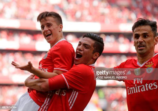 Benfica's Argentinian forward Franco Cervi celebrates with Mexican forward Raul Jimenez and Brazilian forward Jonas after scoring during the...