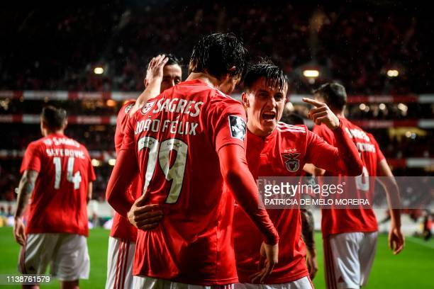 Benfica's Argentinian forward Franco Cervi celebrates with teammates after scoring a goal during the Portuguese League football match between SL...