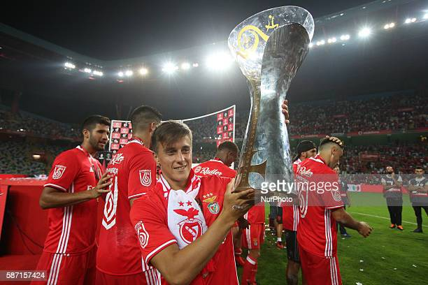 Benfica's Argentinian forward Franco Cervi lifts the trophy game during the Candido de Oliveira Super Cup match between SL Benfica and SC Braga in...