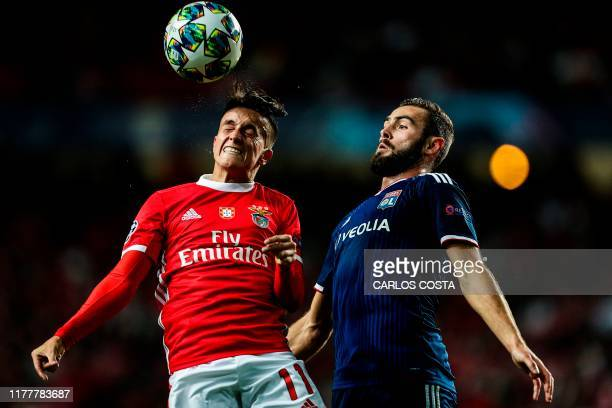 Benfica's Argentinian forward Franco Cervi vies with Lyon's French midfielder Lucas Tousart during the UEFA Champions League Group G football match...