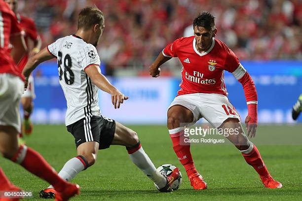 Benfica's Argentinian forward Toto Salvio vies with Besiktas JK's defender Caner Erkin from Turkey during the UEFA Champions League Match between SL...