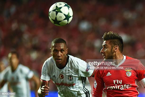 Benfica's Argentinian midfielder Eduardo Salvio vies with Besiktas' Brazilian defender Marcelo Guedes during the UEFA Champions League football match...