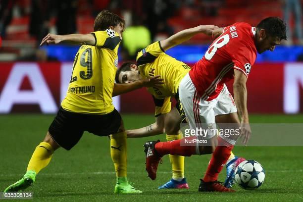Benfica's Argentinian midfielder Eduardo Salvio vies with Dortmund's defender Marcel Schmelzer and Dortmund's defender Raphael Guerreiro during the...