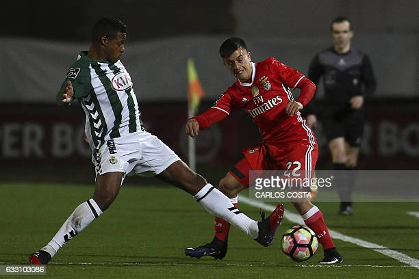 Benfica's Argentinian midfielder Franco Cervi vies Vitoria Setubal's Bissau Guinean defender Vasco Fernandes during the Portuguese league football...