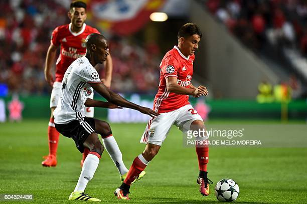 Benfica's Argentinian midfielder Franco Cervi vies with Besiktas' Brazilian defender Marcelo Guedes during the UEFA Champions League football match...